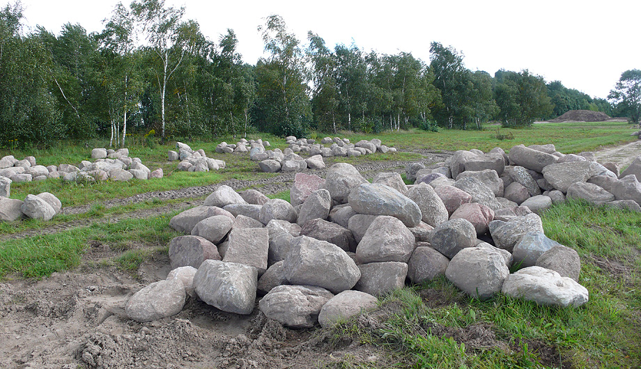 Decorative boulders, awaiting tedious redistribution by landscape architects.