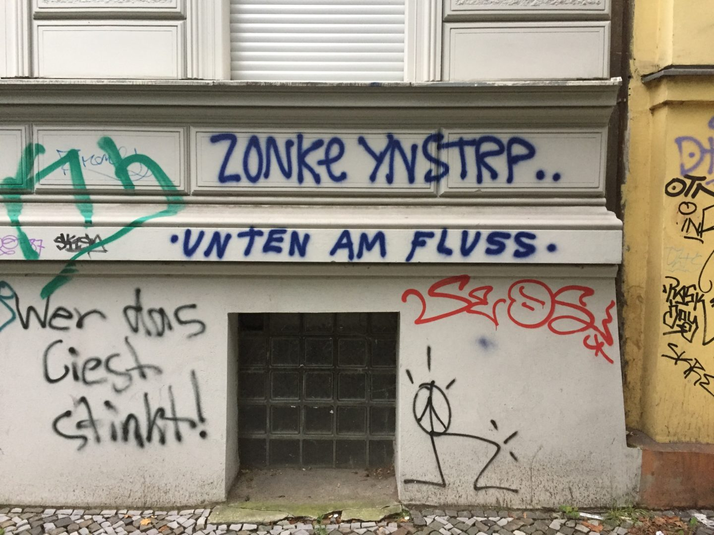 """A graffito on a wall in the Kreuzberg district of Berlin. It reads: """"Unten am Fluss"""", which means, Down By The River."""
